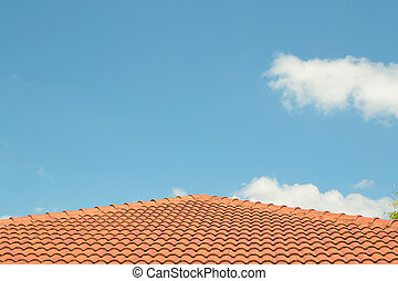 photo of a concrete tiled roof, roofing materials against...