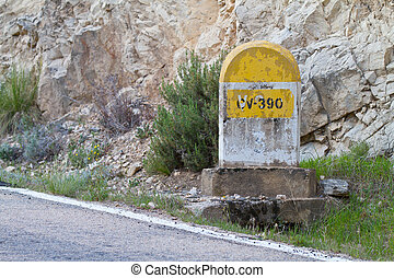 Milestone in the mountains - Milestone along an old road in...