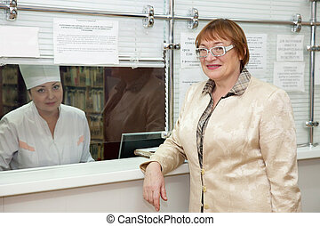 Woman waiting  for patient's records