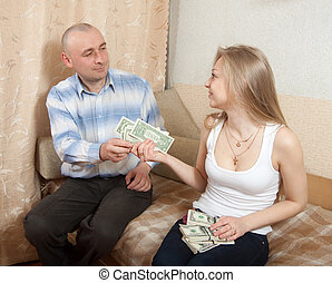 wife gives her husband the money - The wife gives her...