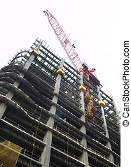 Modern Highrise Construction Site - The massive steel frame...