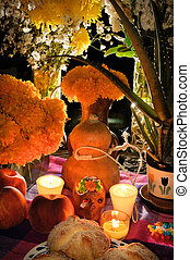 Mexican day of the dead offering altar (Dia de Muertos) -...