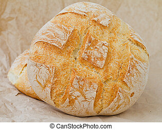 a large round breads closeup photo - a large round loaf of...