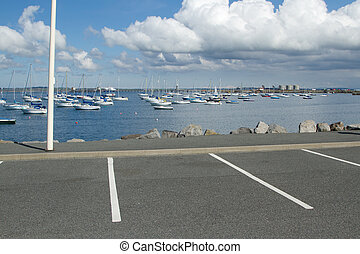 Marina parking bays. - Car park area marked in white lines...