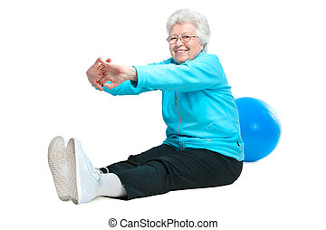 Attractive senior woman at health club, doing stretching...