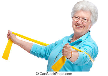 senior woman at gym - senior woman doing exercises with a...