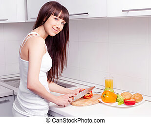 woman cooking - beautiful young woman cutting vegetables for...