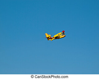 Fire fighter airplane on blue sky background