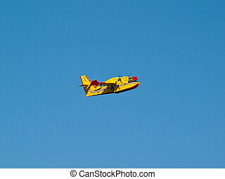Fire fighter airplane flying on blue sky