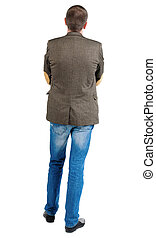 Back view of handsome business man in jacket .  looking ahead of