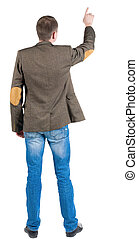 Back view of pointing business man in jacket