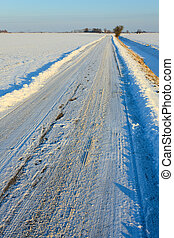 Snow covered road in winterlandscape - Snow covered road in...