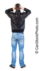 Back view of shocked man in jacket .