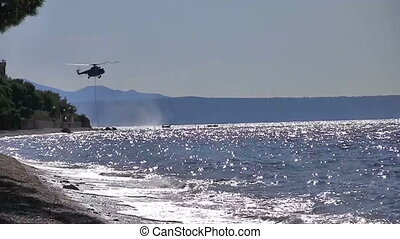Helicopter in action at sea
