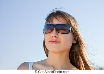 young blond woman in sunglasses