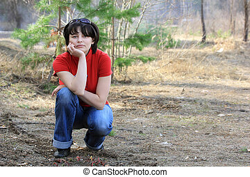 Beautiful girl in spring forest