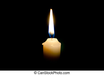 lighted candle - Burning candle on a black background