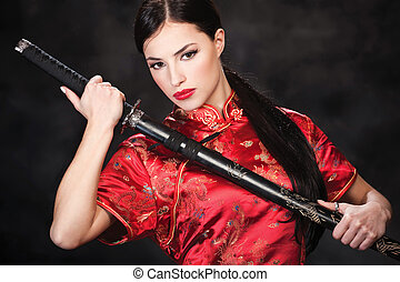 woman and katanasword - Pretty woman holding katana weapon