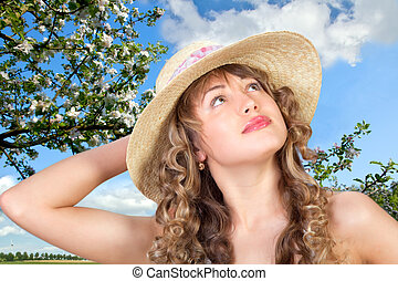 young woman wearing a straw hat - Closeup portrait of a cute...