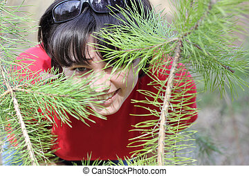 Beautiful laughing girl in spring forest