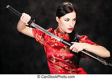 woman and katana/sword - beautiful girl dressed in a kimono...