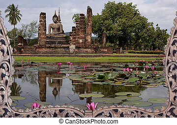 Buddha statue with reflex on the lotus pool.