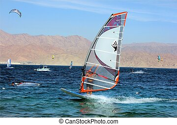 skating surfing in the Red Sea - view of a windsurfer in the...