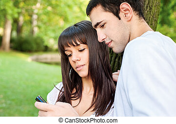 young couple and mobile phone