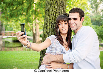 young couple taking picture of themselves