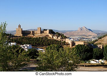 Castle, Antequera, Spain. - Castle fortress with townhouses...