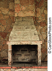 Old Brick Oven - Empty and Fireless brick oven against stone...