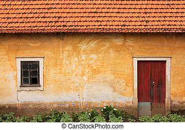 Orange Old House - Abandoned facade with wood windows and...