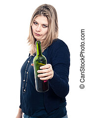 Frustrated drunk woman holding bottle of wine, isolated on...