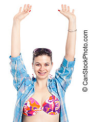 Happy woman in swimsuit with hands up