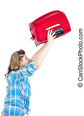 Traveller woman lifting luggage