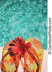 Flip Flops on white towel pool