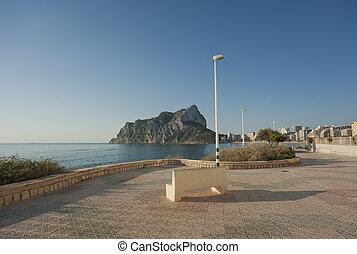 Sunny beach promenade at Calpe, Costa Blanca, Spain