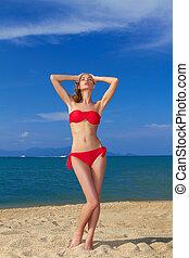 Sexy woman in red bikini