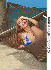 High-spirited laughing woman in hammock - High-spirited...