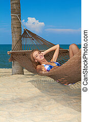 Woman enjoying the peace of a tropical beach