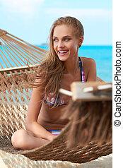 Beautiful woman in hammock