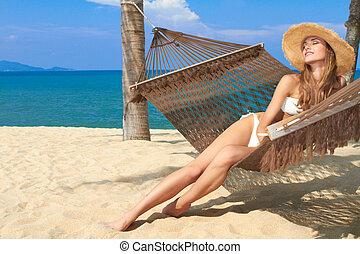 Elegant woman reclining in a hammock - Elegant woman in a...