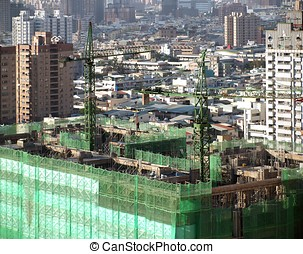 Large Scale Construction Site - Construction site with two...