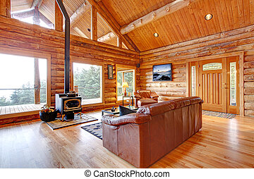 Luxury log cabin living room with leather sofa. - Large...
