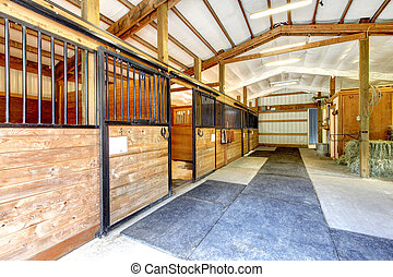 Horse farm stable shed interior. - Horse farm stable shed...