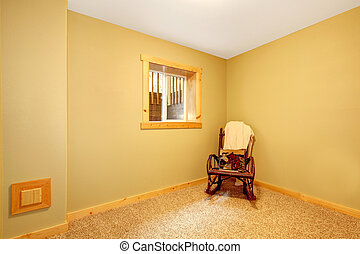 Simple empty basement bedroom with chair. - Simple empty...