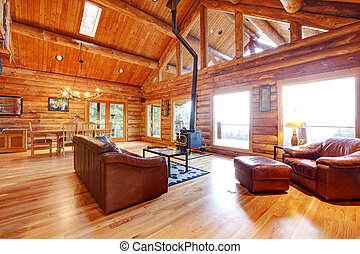 Luxury log cabin living room with leather sofa - Large...