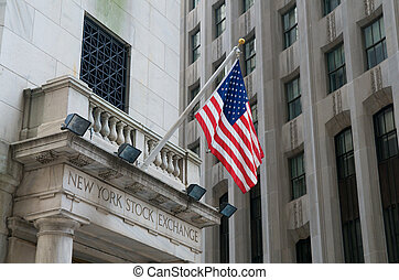 New York Stock Exchange - USA Flags on Wall Street at the...