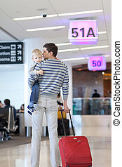 father and son at the airport - father and son waiting...