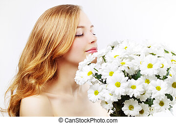 beautiful girl with white chrysanthemum on light background
